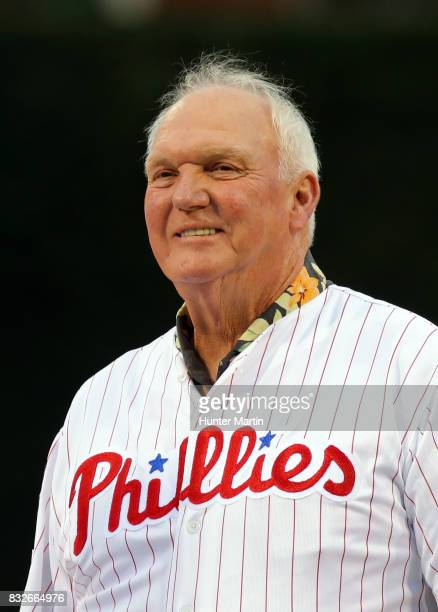 Former Philadelphia Phillies manager Charlie Manuel smiles as he stands on the field during the Wall of Fame ceremony before a game between the...