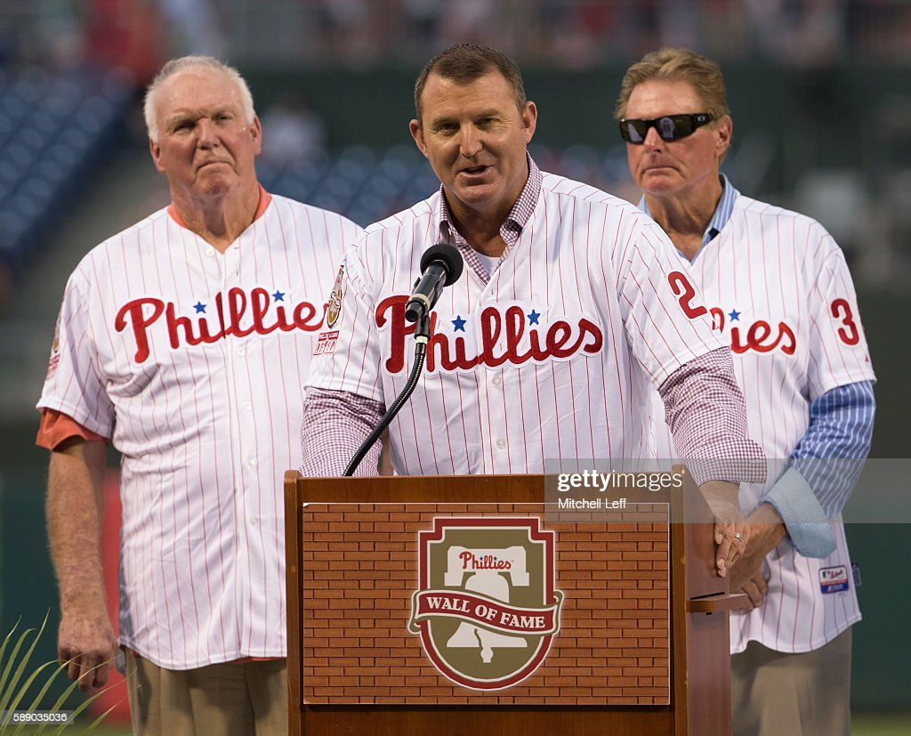 Former Philadelphia Phillies player Jim Thome talks to the crowd with former Philadelphia Phillies manager Charlie Manuel and former Philadelphia Phillies pitcher Steve Carlton standing behind him during his Phillies Wall of Fame induction prior the game against the Colorado Rockies at Citizens Bank Park on August 12, 2016 in Philadelphia, Pennsylvania. The Phillies defeated the Rockies 10-6.