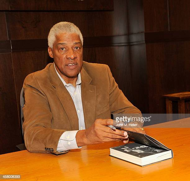 Former Philidelphia 76ers forward Julius Erving signs copies of his new book 'Dr J The Autobiography' at the Barnes Noble bookstore at The Grove on...