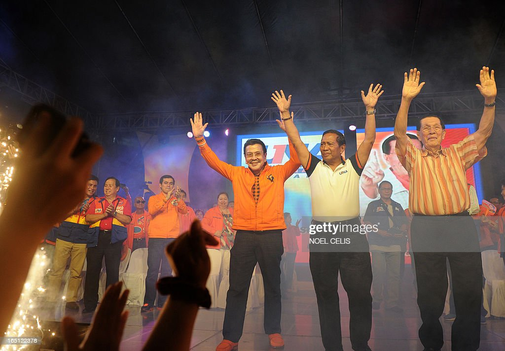 Former Philippine president and candidate for mayor of Manila Joseph Estrada (3rd R), Philippine's Vice President Jejomar Binay (2nd R) and Senate President Juan Ponce Enrile (R) wave to the crowd during Estrada's campaign launch on March 31, 2013 in Manila. In typically colourful fashion, graft-tainted former Philippine president Joseph Estrada launched his campaign for mayor of Manila Sunday in what he described as his 'last hurrah' in politics. The one-time movie actor, who turns 76 on April 19, said he wanted to end his political career as the mayor of a city where he was born and in whose sprawling slums he remains hugely popular.