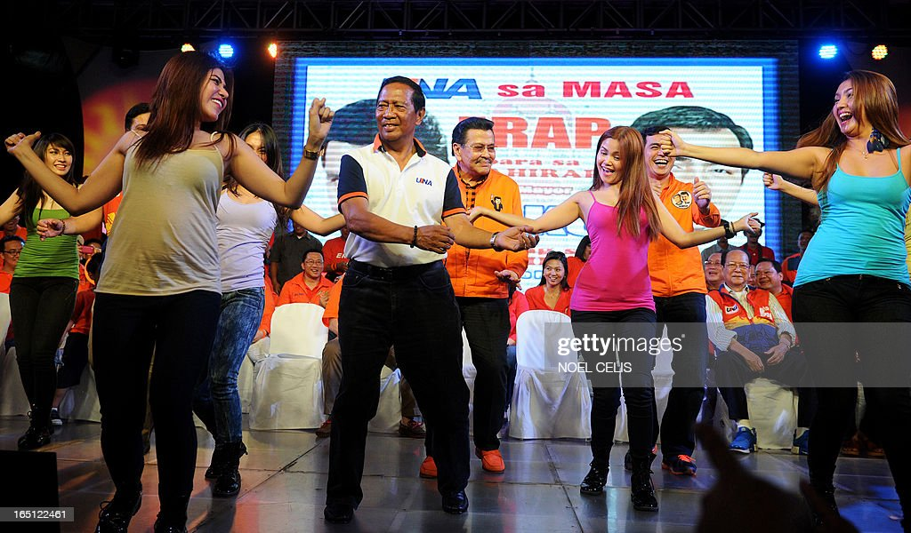 Former Philippine president and candidate for mayor of Manila Joseph Estrada (2nd L) and Philippine's Vice President Jejomar Binay (2nd L) dance onstage with performers during Estrada's campaign launch on March 31, 2013 in Manila. In typically colourful fashion, graft-tainted former Philippine president Joseph Estrada launched his campaign for mayor of Manila Sunday in what he described as his 'last hurrah' in politics. The one-time movie actor, who turns 76 on April 19, said he wanted to end his political career as the mayor of a city where he was born and in whose sprawling slums he remains hugely popular.