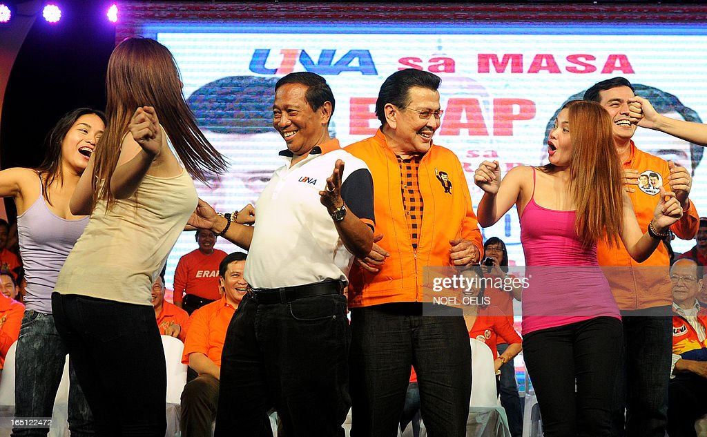 Former Philippine president and candidate for mayor of Manila Joseph Estrada (3rd R) and Philippine's Vice President Jejomar Binay (3rd L) dance onstage with performers during Estrada's campaign launch on March 31, 2013 in Manila. In typically colourful fashion, graft-tainted former Philippine president Joseph Estrada launched his campaign for mayor of Manila Sunday in what he described as his 'last hurrah' in politics. The one-time movie actor, who turns 76 on April 19, said he wanted to end his political career as the mayor of a city where he was born and in whose sprawling slums he remains hugely popular.