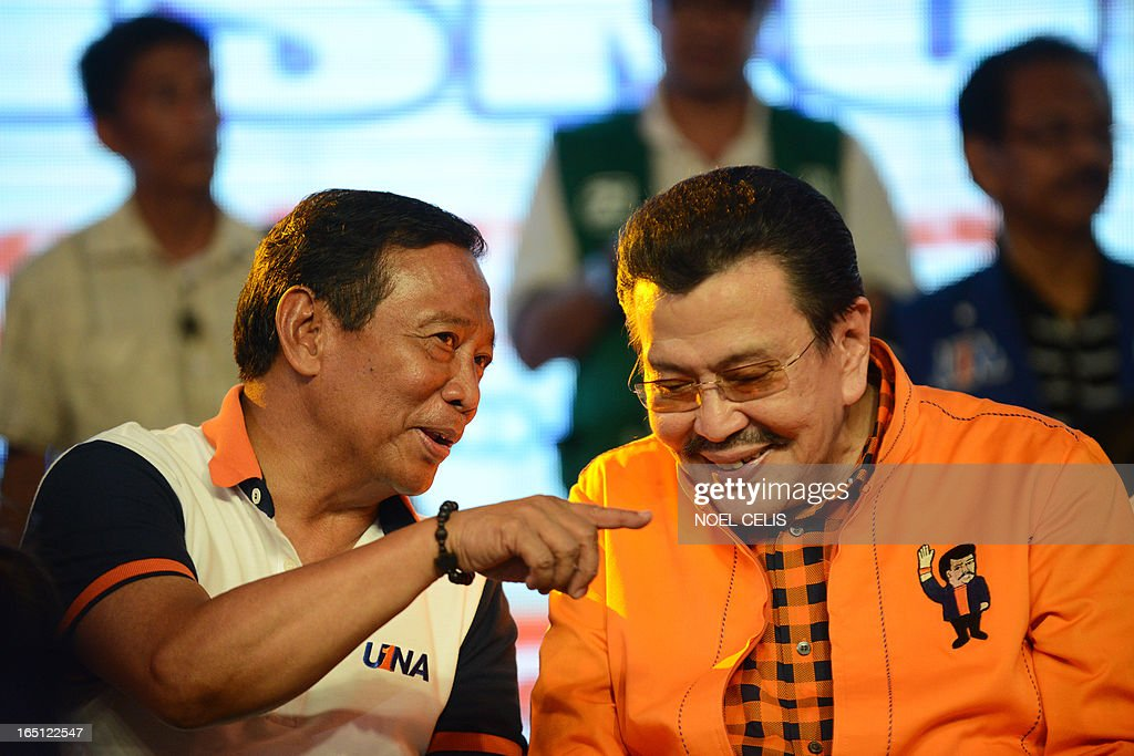Former Philippine president and candidate for mayor of Manila Joseph Estrada (R) speaks with Philippine's Vice President Jejomar Binay during Estrada's campaign launch on March 31, 2013 in Manila. In typically colourful fashion, graft-tainted former Philippine president Joseph Estrada launched his campaign for mayor of Manila Sunday in what he described as his 'last hurrah' in politics. The one-time movie actor, who turns 76 on April 19, said he wanted to end his political career as the mayor of a city where he was born and in whose sprawling slums he remains hugely popular.