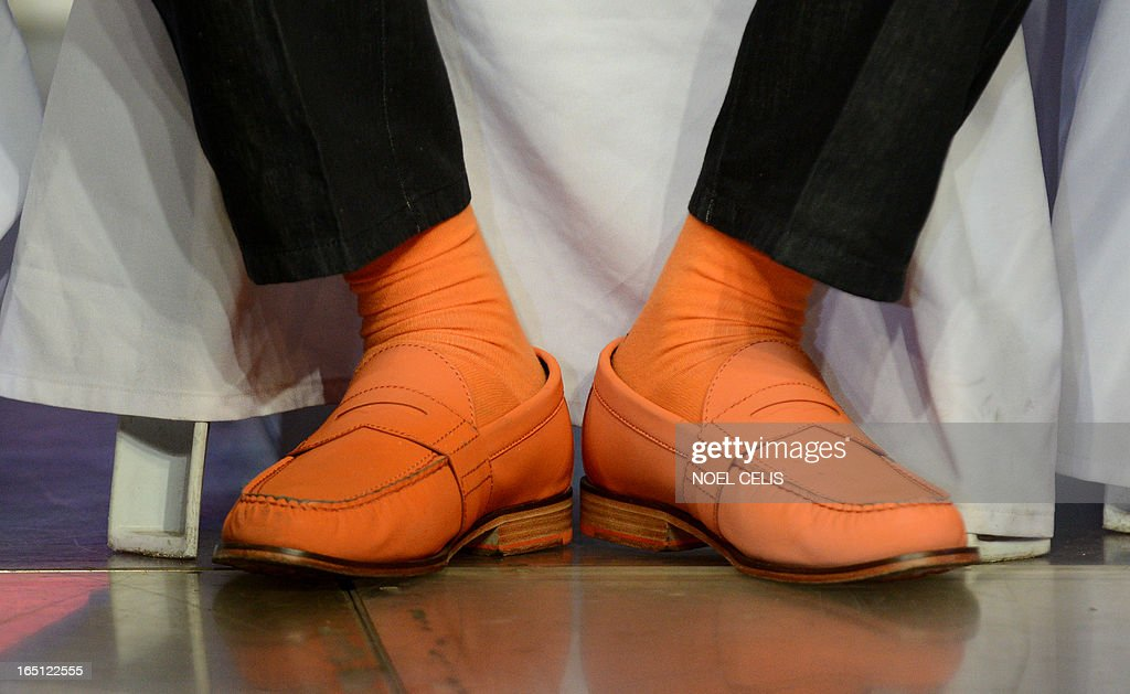 Former Philippine president and candidate for mayor of Manila Joseph Estrada wears orange socks and shoes during his campaign launch on March 31, 2013 in Manila. In typically colourful fashion, graft-tainted former Philippine president Joseph Estrada launched his campaign for mayor of Manila Sunday in what he described as his 'last hurrah' in politics. The one-time movie actor, who turns 76 on April 19, said he wanted to end his political career as the mayor of a city where he was born and in whose sprawling slums he remains hugely popular.