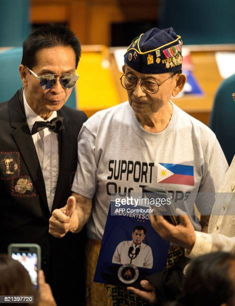 Former Philippine president Fidel Ramos gives a thumbs up as he arrives at the House of Representatives in Manila on July 24 before Philippine...