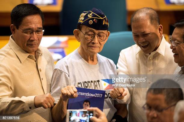 Former Philippine president Fidel Ramos poses for a photo as he arrives at the House of Representatives in Manila on July 24 before Philippine...