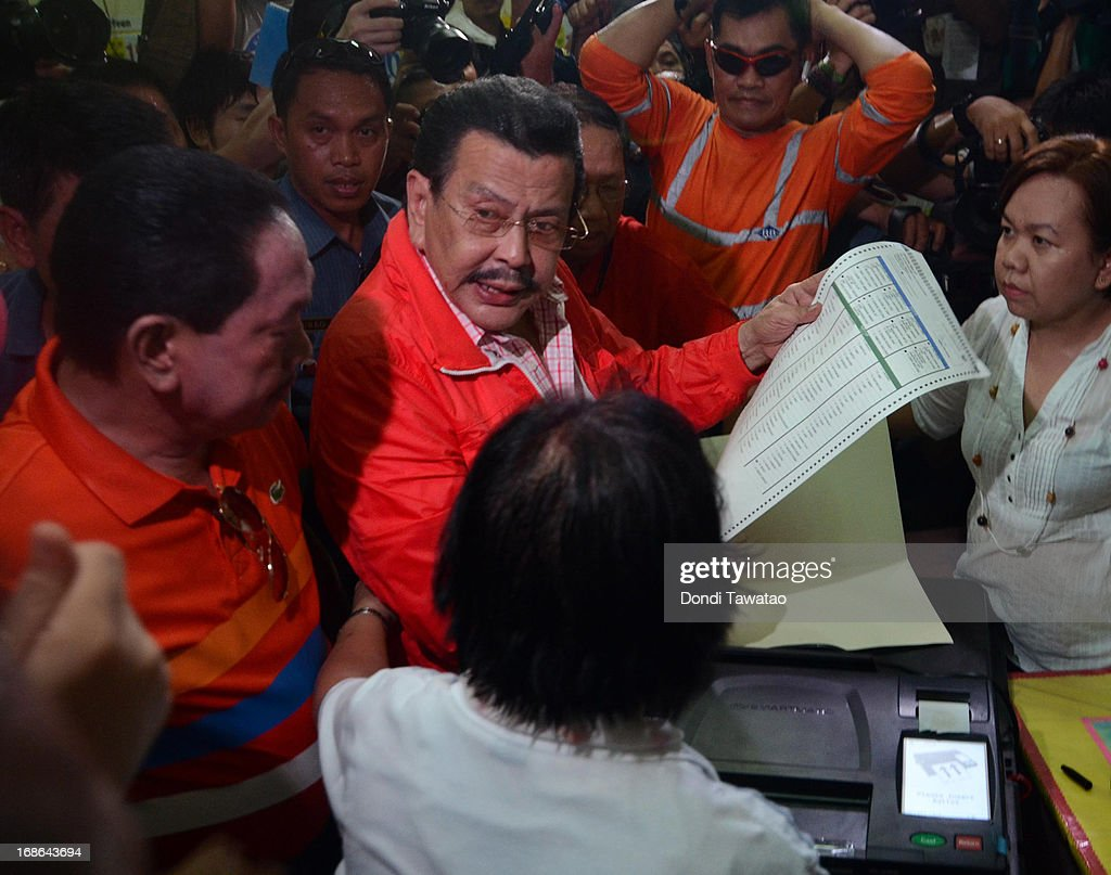 Former Philippine president <a gi-track='captionPersonalityLinkClicked' href=/galleries/search?phrase=Joseph+Estrada&family=editorial&specificpeople=553277 ng-click='$event.stopPropagation()'>Joseph Estrada</a> casts his vote on May 13, 2013 in Manila, Philippines. The former president and movie actor, who was deposed in a popular revolt in 2001 and put under house arrest and eventually pardoned, is running for a mayoralty post in the city of Manila. Millions of Filipinos are casting their votes for the mid-term elections to determine their choice candidates for local posts as well as the Upper and Lower House of the Philippine Congress. So far, over 50 people have been killed in the run up to polling day for the elections that have been marred by violence and accusations of corruption and neopotism.