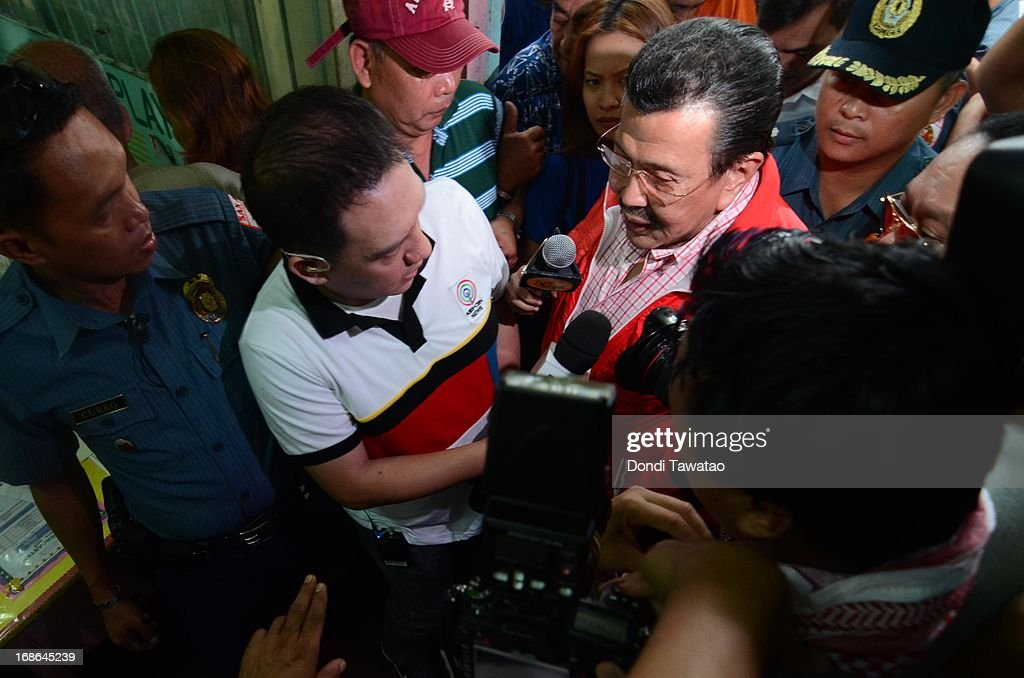 Former Philippine president <a gi-track='captionPersonalityLinkClicked' href=/galleries/search?phrase=Joseph+Estrada&family=editorial&specificpeople=553277 ng-click='$event.stopPropagation()'>Joseph Estrada</a> is interviewed by journalists as he casts his vote on May 13, 2013 in Manila, Philippines. The former president and movie actor, who was deposed in a popular revolt in 2001 and put under house arrest and eventually pardoned, is running for a mayoralty post in the city of Manila. Millions of Filipinos are casting their votes for the mid-term elections to determine their choice candidates for local posts as well as the Upper and Lower House of the Philippine Congress. So far, over 50 people have been killed in the run up to polling day for the elections that have been marred by violence and accusations of corruption and neopotism.