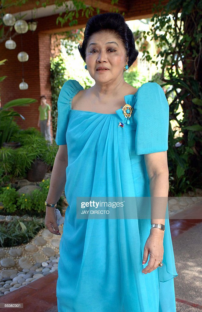 Former Philippines first lady <a gi-track='captionPersonalityLinkClicked' href=/galleries/search?phrase=Imelda+Marcos&family=editorial&specificpeople=217389 ng-click='$event.stopPropagation()'>Imelda Marcos</a> takes a walk at a resort during a visit to her late husband's home province .in Laoag nothern Philippines, 12 September 2005. The widow of former president Ferdinand Marcos threatened to sue international auction houses if they took part in the planned auction of more than 30 bags of jewelry that she says were illegally seized by the government when her late husband was toppled from power in 1986. AFP PHOTO/Jay DIRECTO
