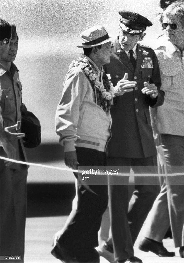 http://media.gettyimages.com/photos/former-philippines-president-ferdinand-marcos-listens-26-february-to-picture-id107352793