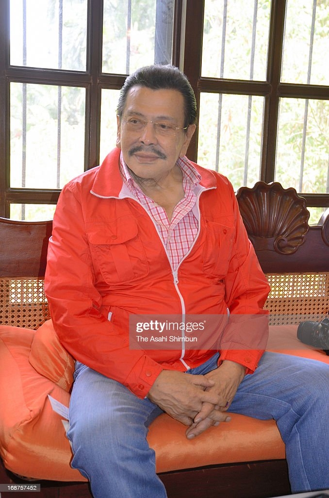 Former Philippines President <a gi-track='captionPersonalityLinkClicked' href=/galleries/search?phrase=Joseph+Estrada&family=editorial&specificpeople=553277 ng-click='$event.stopPropagation()'>Joseph Estrada</a> responds to reporters at poll after running for Manila mayor on May 13, 2013 in Manila, Philippines.