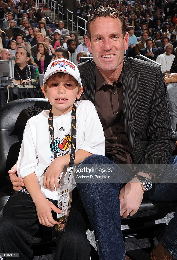 Former Phoenix Suns player Dan Majerle sits with son Max Majerle during Foot Locker ThreePoint Shootout on AllStar Saturday Night part of 2009 NBA...