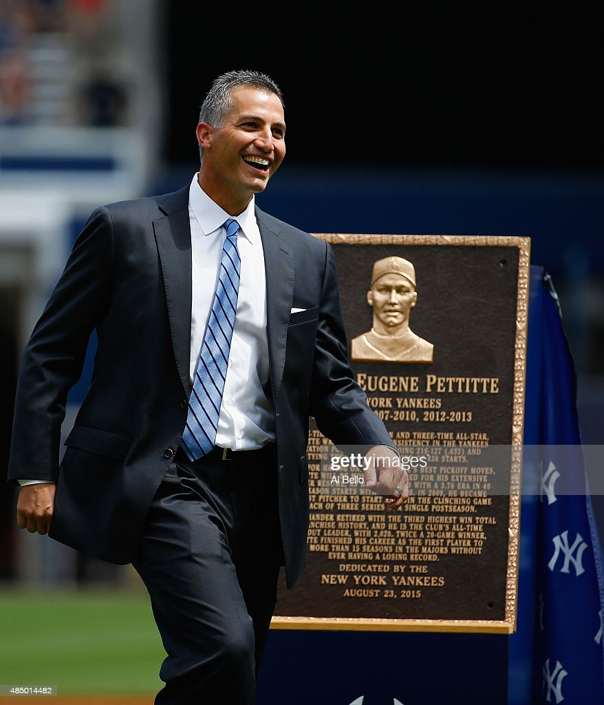 Former pitcher <a gi-track='captionPersonalityLinkClicked' href=/galleries/search?phrase=Andy+Pettitte&family=editorial&specificpeople=201753 ng-click='$event.stopPropagation()'>Andy Pettitte</a> of the New York Yankees stands next to his retired plaque which will go into Monument Park before the game against the Cleveland Indiand at Yankee Stadium on August 23, 2015 in New York City.