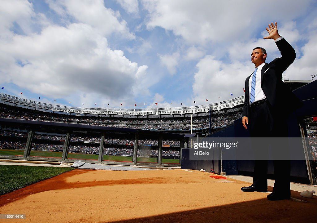 Former pitcher <a gi-track='captionPersonalityLinkClicked' href=/galleries/search?phrase=Andy+Pettitte&family=editorial&specificpeople=201753 ng-click='$event.stopPropagation()'>Andy Pettitte</a> of the New York Yankees waves to the crowd as he waits in the bullpen to unveil his retired number in Monument Park before the game against the Cleveland Indiand at Yankee Stadium on August 23, 2015 in New York City.