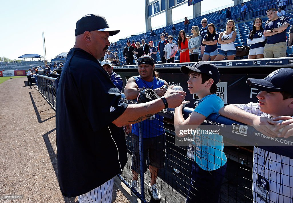 Former pitcher David Wells of the New York Yankees talks with some young fans about pitching just before the start of the Grapefruit League Spring Training Game against the Miami Marlins at George M. Steinbrenner Field on March 15, 2013 in Tampa, Florida.