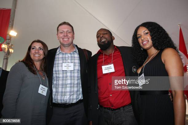 Former pitcher Roy Halladay of the Toronto Blue Jays poses with his wife Brandy Halladay as former player Vladimir Guerrero of the Montreal Expos...