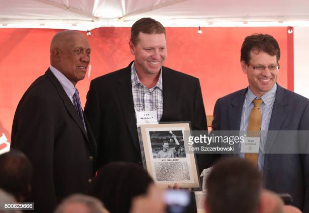Former pitcher Roy Halladay of the Toronto Blue Jays poses with former pitcher Ferguson Jenkins and Canadian Baseball Hall of Fame and Museum Chair...