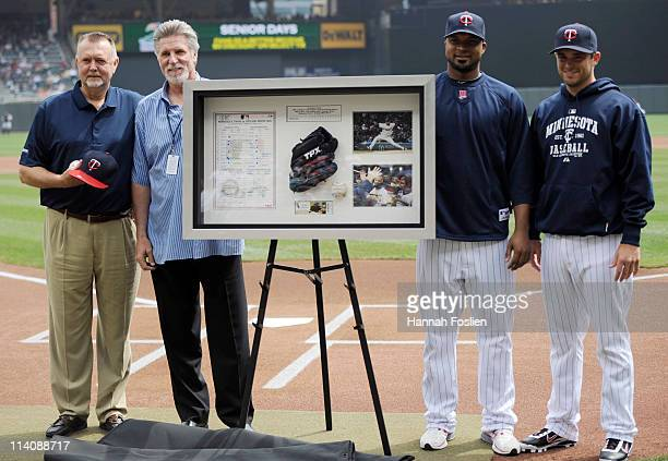 Former pitchers Bert Blyleven and Jack Morris of the Minnesota Twins present Francisco Liriano and catcher Drew Butera of the Minnesota Twins with a...