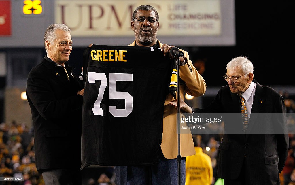 Former Pittsburgh Steelers defensive tackle <a gi-track='captionPersonalityLinkClicked' href=/galleries/search?phrase=Joe+Greene+-+American+Football+Player&family=editorial&specificpeople=12902363 ng-click='$event.stopPropagation()'>Joe Greene</a> #75 has his number retired during a ceremony with Steelers President Art Rooney ll (L) and Chairman <a gi-track='captionPersonalityLinkClicked' href=/galleries/search?phrase=Dan+Rooney&family=editorial&specificpeople=725695 ng-click='$event.stopPropagation()'>Dan Rooney</a> (R) during halftime against the Baltimore Ravens at Heinz Field on November 2, 2014 in Pittsburgh, Pennsylvania.