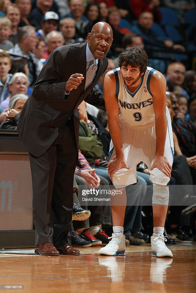Former player and Coach Terry Porter speaks with Ricky Rubio #9 of the Minnesota Timberwolves during a timeout against the Houston Rockets during the game on January 19, 2013 at Target Center in Minneapolis, Minnesota.