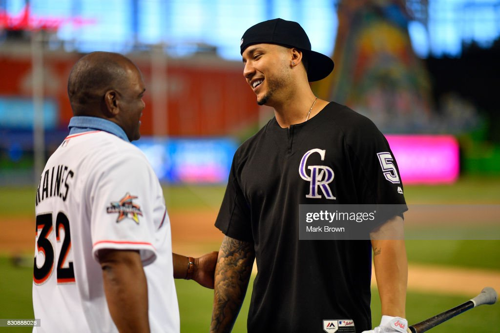 Former player and Hall of Famer Tim Raines greets Carlos Gonzalez #5 of the Colorado Rockies before the game between the Miami Marlins and the Colorado Rockies at Marlins Park on August 12, 2017 in Miami, Florida.
