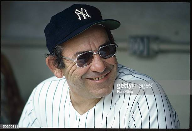 Former player and manager Yogi Berra of the New York Yankees sits in the dugout at Yankee Stadium in Bronx New York circa 1982 Berra managed the...