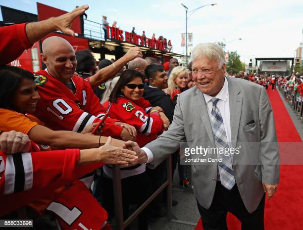 Former player and member of the Hockey Hall of Fame Bobby Hull of the Chicago Blackhawks greets fans during a 'red carpet' event before the season...