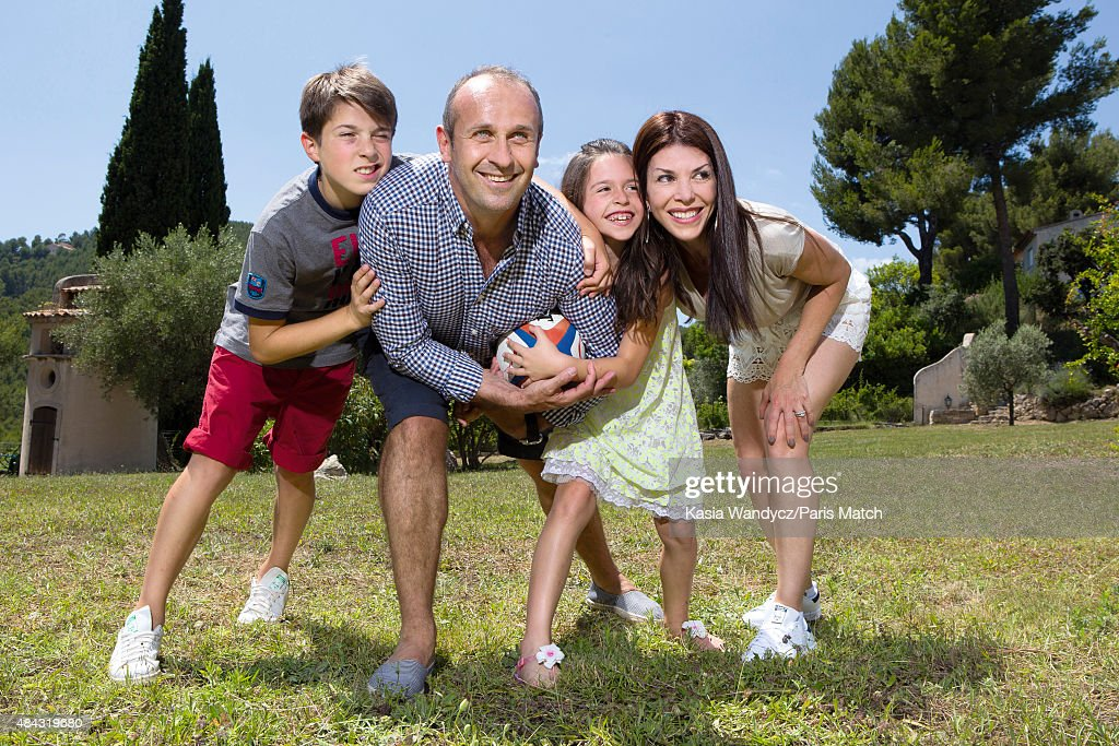 Former player and rugby coach <a gi-track='captionPersonalityLinkClicked' href=/galleries/search?phrase=Philippe+Saint-Andre&family=editorial&specificpeople=2172154 ng-click='$event.stopPropagation()'>Philippe Saint-Andre</a> is photographed with his wife Patricia and their children Jules and Paloma at their home for Paris Match on June 17, 2015 near Toulon, France.