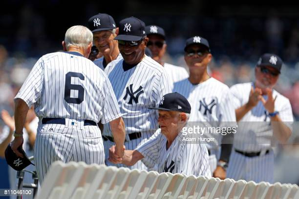 Former player Dr Bobby Brown shakes hands with former pitcher Don Larsen of the New York Yankees during introductions for the New York Yankees 71st...