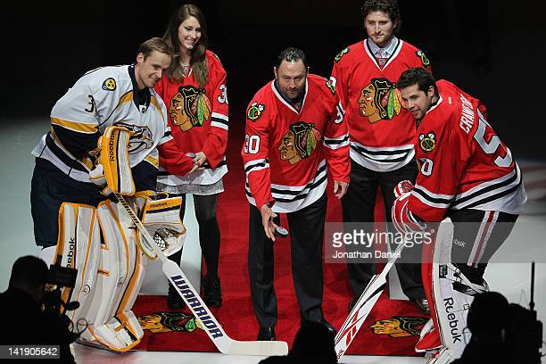 Former player Ed Belfour of the Chicago Blackhawks drops a ceremonial puck between Pekka Rinne of the Nashville Predators and Corey Crawford of the...