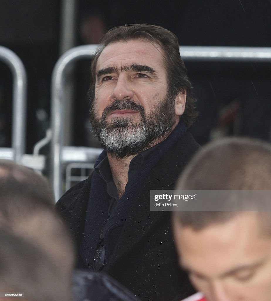 Former player <a gi-track='captionPersonalityLinkClicked' href=/galleries/search?phrase=Eric+Cantona&family=editorial&specificpeople=211325 ng-click='$event.stopPropagation()'>Eric Cantona</a> attends the unveiling of a statue of Manager Sir Alex Ferguson of Manchester United at Old Trafford on November 23, 2012 in Manchester, England.