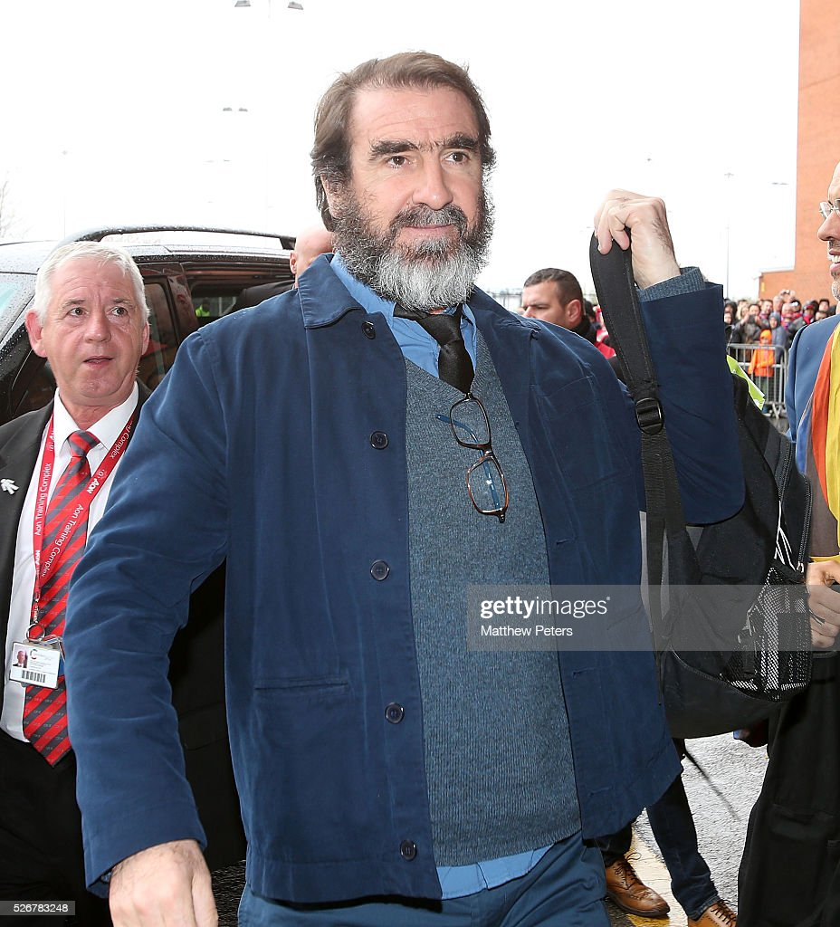 Former player Eric Cantona of Manchester United arrives at Old Trafford ahead of the Barclays Premier League match between Manchester United and Leicester City at Old Trafford on May 1, 2016 in Manchester, England.