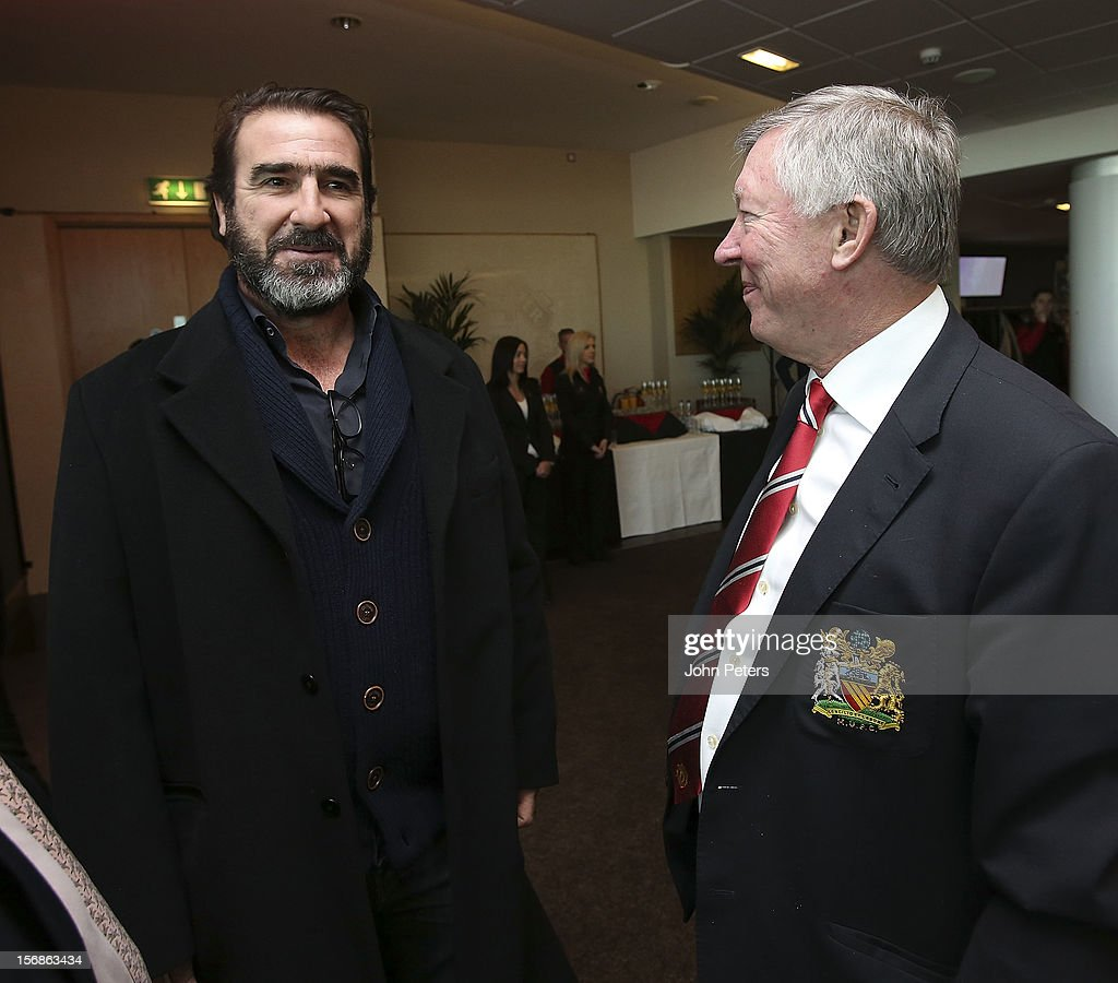 Former player <a gi-track='captionPersonalityLinkClicked' href=/galleries/search?phrase=Eric+Cantona&family=editorial&specificpeople=211325 ng-click='$event.stopPropagation()'>Eric Cantona</a> talks with Sir <a gi-track='captionPersonalityLinkClicked' href=/galleries/search?phrase=Alex+Ferguson&family=editorial&specificpeople=203067 ng-click='$event.stopPropagation()'>Alex Ferguson</a> after the unveiling of a statue of Manager Sir <a gi-track='captionPersonalityLinkClicked' href=/galleries/search?phrase=Alex+Ferguson&family=editorial&specificpeople=203067 ng-click='$event.stopPropagation()'>Alex Ferguson</a> of Manchester United at Old Trafford on November 23, 2012 in Manchester, England.