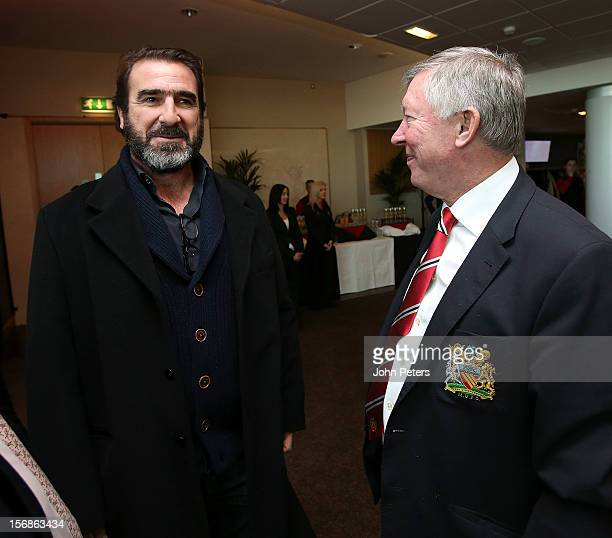 Former player Eric Cantona talks with Sir Alex Ferguson after the unveiling of a statue of Manager Sir Alex Ferguson of Manchester United at Old...