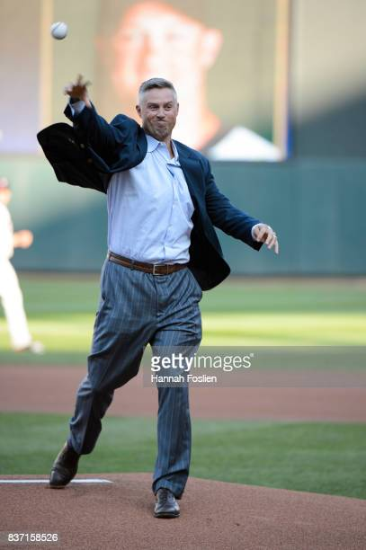 Former player for the Minnesota Twins Michael Cuddyer delivers a ceremonial pitch as he is inducted into the Minnesota Twins Hall of Fame before the...