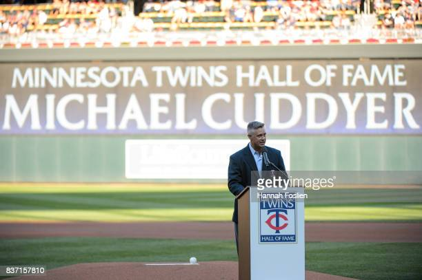 Former player for the Minnesota Twins Michael Cuddyer speaks as he is inducted into the Minnesota Twins Hall of Fame before the game between the...