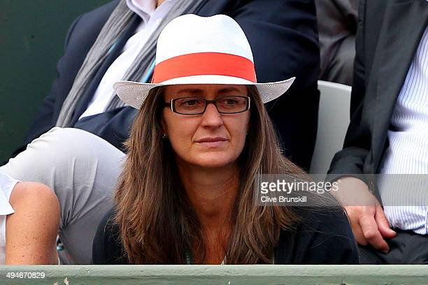 Former player Mary Pierce of France watches the men's singles match between JoWilfried Tsonga of France and Jerzy Janowicz of Poland on day six of...
