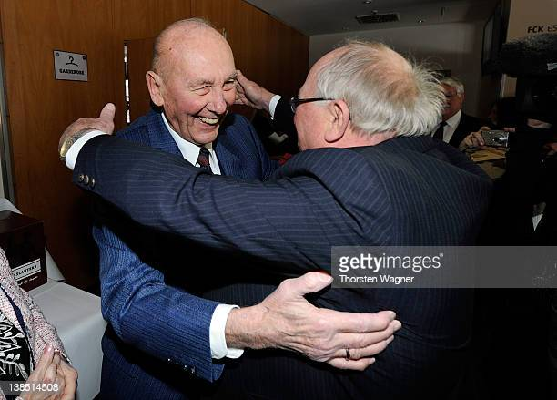 Former player of German National Football team Uwe Seeler congratulates Horst Eckel during the Horst Eckel's 80th birthday celebration at VIP Lounge...