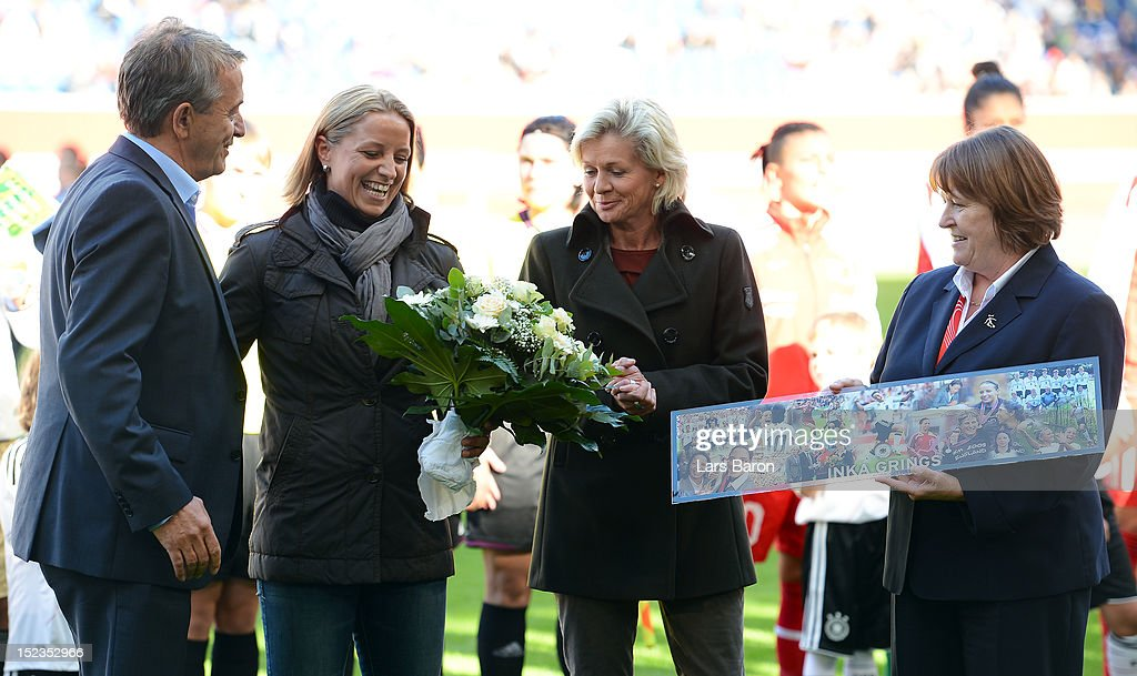 Former player of Germany Inka Grings is honoured by Wolfgang Niersbach, president of Deutscher Fussball Bund DFB, head coach Silvia Neid of Germany and Hannelore Ratzeburg, vice president of Deutscher Fussball Bund DFB, prior to the UEFA Womens Euro 2013 qualification match between Germany and Turkey at Schauinsland-Reisen-Arena on September 19, 2012 in Duisburg, Germany.