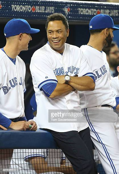 Former player Roberto Alomar of the Toronto Blue Jays talks to Aaron Sanchez before the start of MLB game action against the Tampa Bay Rays on April...