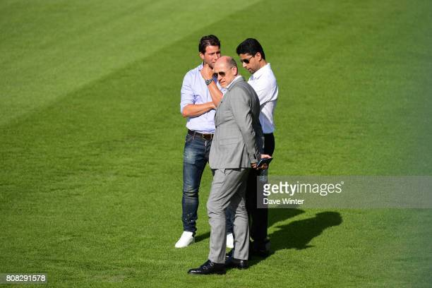 Former player Sherrer Maxwell of PSG who has now joined the staff PSG sporting director Antero Henrique and PSG president Nasser AlKhelaifi during...