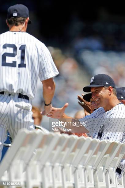 Former player Tino Martinez shakes hands with Paul O'Neill of the New York Yankees during introductions for the New York Yankees 71st Old Timers Day...