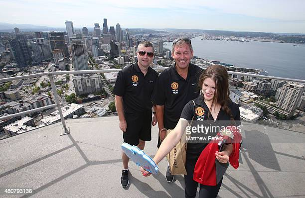 Former players Denis Irwin and Bryan Robson of Manchester United pose on top of the Space Needle as part of their preseason tour of the USA on July...
