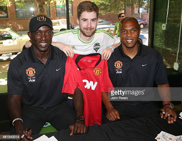 Former players Dwight Yorke and Quinton Fortune of Manchester United meet Seattle Sounders fans at a Meet and Greet event during the club's preseason...
