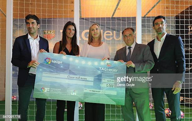 Former players Fernando Sanz and Raul Gonzalez Olga de la Fuente manager of La Liga charity 'Champions for Life' Javier Tebas La liga President and...