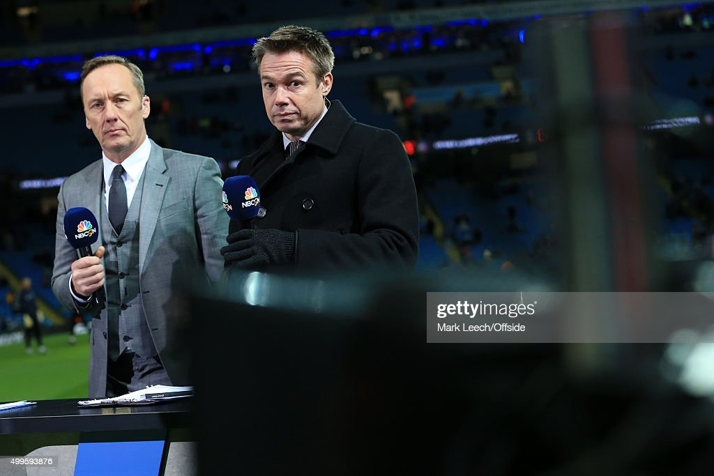 Former players Lee Dixon and Graeme Le Saux working as pitchside pundits for NBC Sports Network during the Barclays Premier League match between...