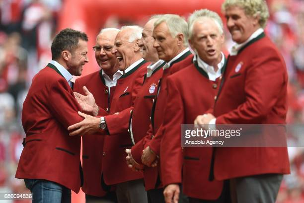 Former players Lothar Matthaus Franz Beckenbauer and Franz Roth of Munich greet each other during the presentation of the 'Bayern Munich Legends'...