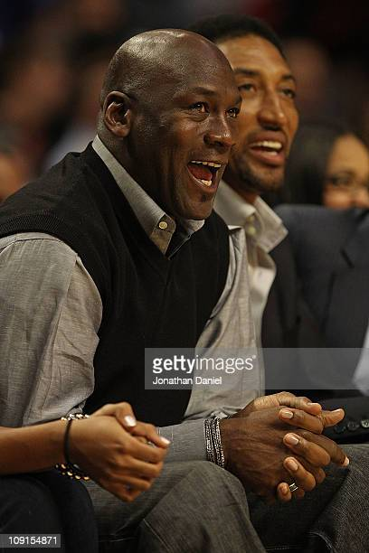 Former players Michael Jordan and Scottie Pippen of the Chicago Bulls enjoy watching a game between the Bulls and the Charlotte Bobcats at the United...