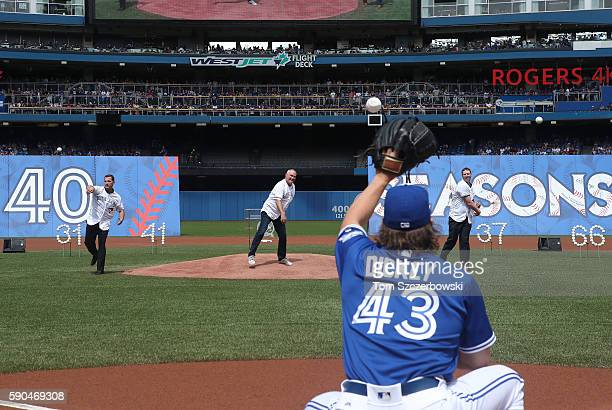 Former players Pat Hentgen of the Toronto Blue Jays and Dave Stieb and Roy Halladay throw out the first pitches during the fortieth season...