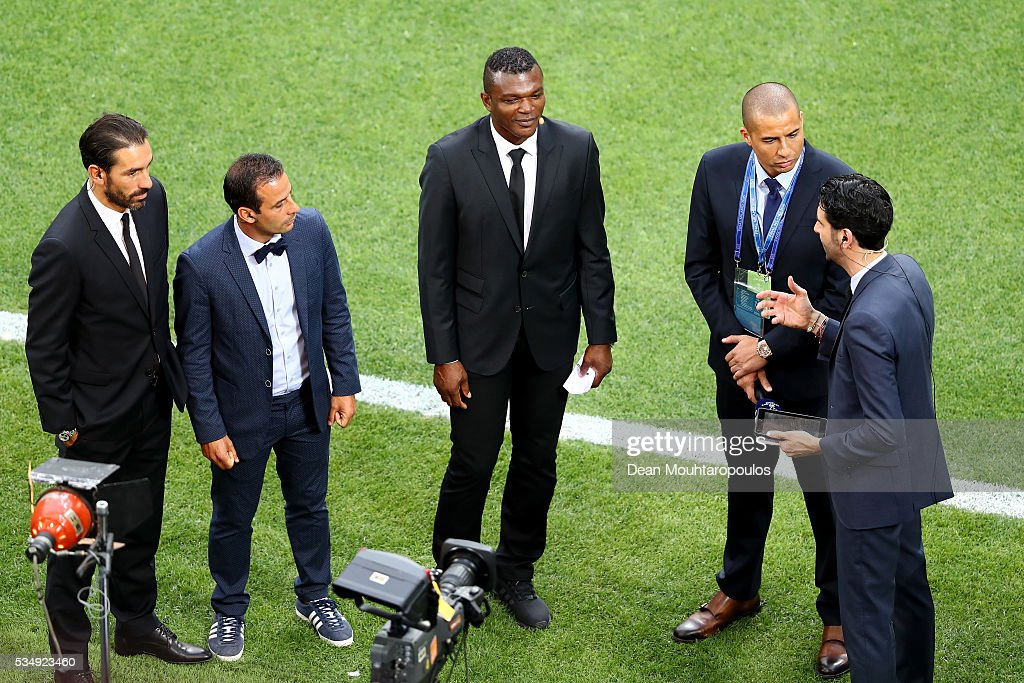 Former players Robert Pires, Ludovic Giuly and Marcel Desailly and David Trezeguet take up their media positions pitchside prior to the UEFA Champions League Final match between Real Madrid and Club Atletico de Madrid at Stadio Giuseppe Meazza on May 28, 2016 in Milan, Italy.